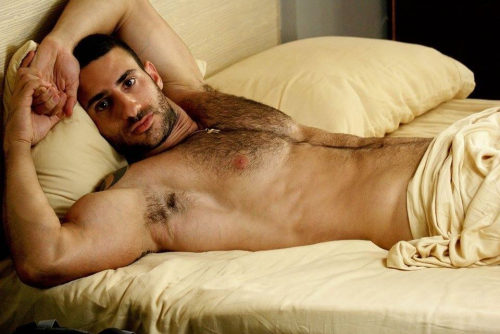 handsome man in bed