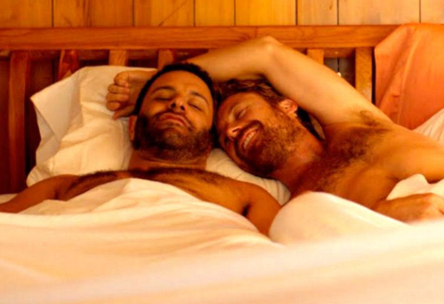 men in bed together, men cuddling