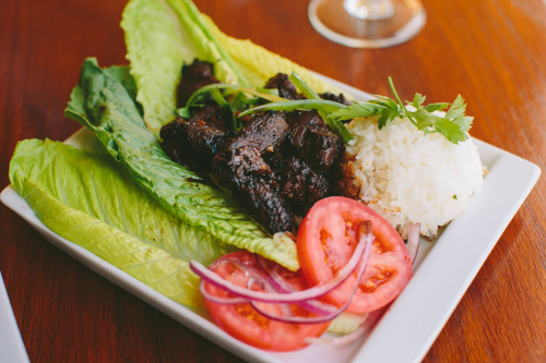 Shown here is Loc Lac Salad (half portion) Beef tenderloin (8oz) caramelized in black pepper, garlic and mushroom soy, fresh lettuce, limegarlic dipping sauce