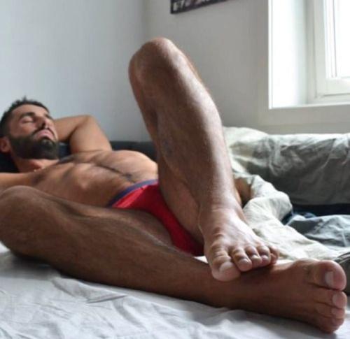 man in bed, red, underwear