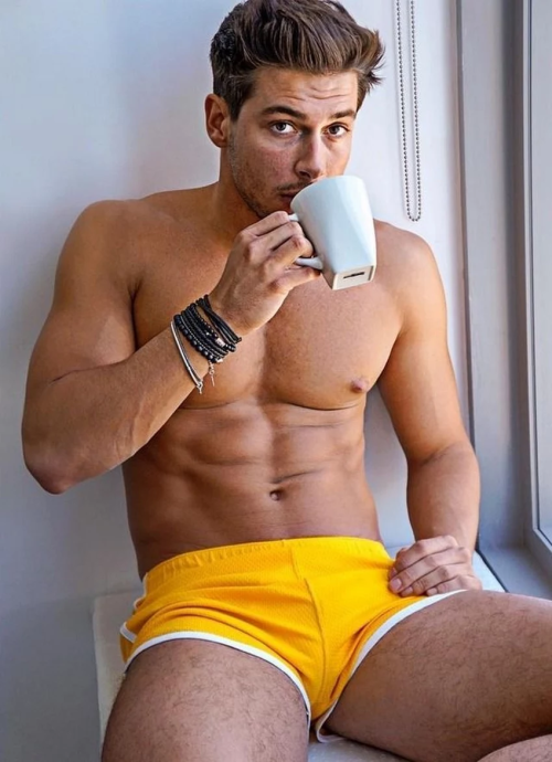 handsome, hunk, man drinking coffee, yellow