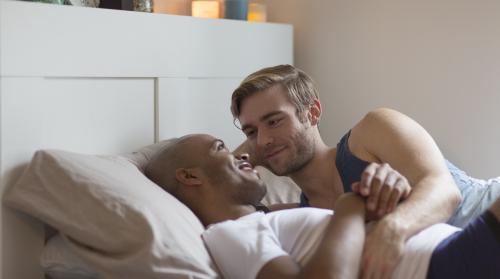 men in bed together