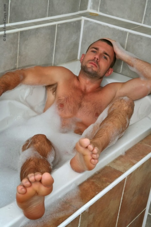 caption this photo, man in a tub, handsome, hunk