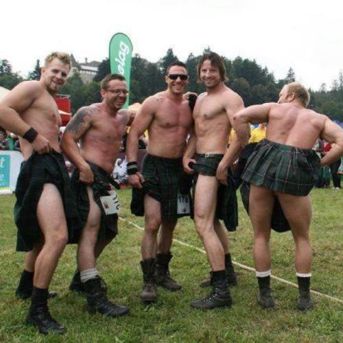 handsome group of men wearing kilts
