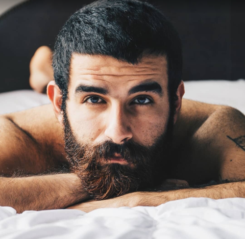 handsome guy in bed, hunk, man with facial hair