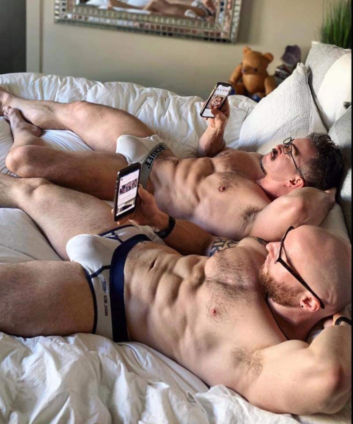 men in bed with phones, handsome, hunk, muscular men