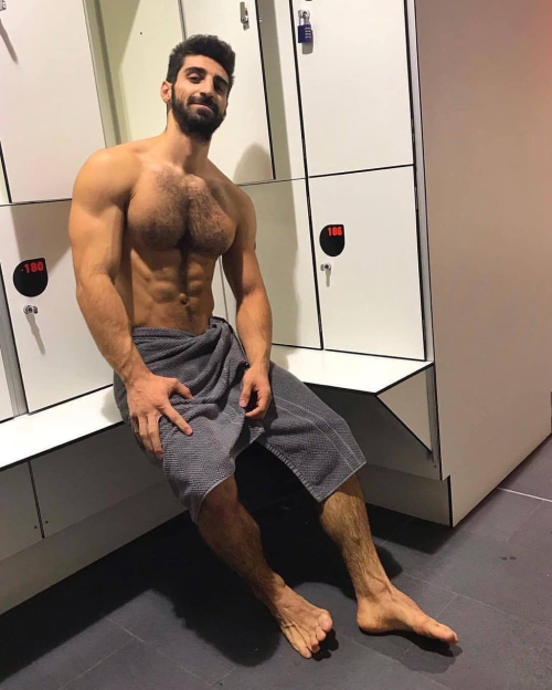 handsome man in a towel at the gym