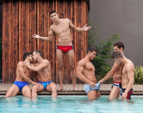 handsome men in speedos, pool party