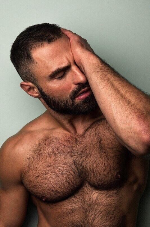 handsome man waking up, hairy chest