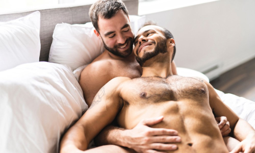men in bed embracing, handsome men in bed, hairy