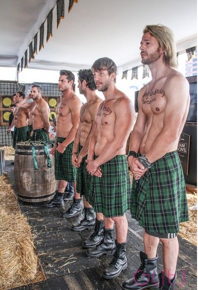 line of handsome men wearing kilts