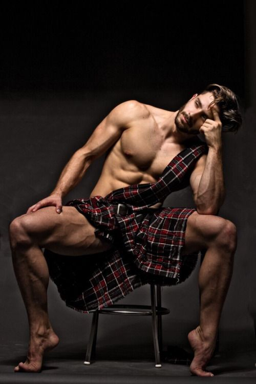 shirtless hunk wearing a kilt