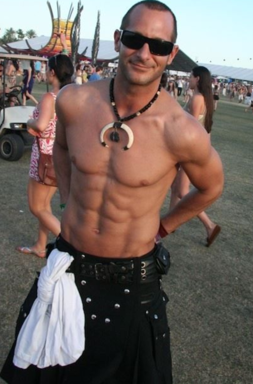 handsome shirtless guy in a kilt