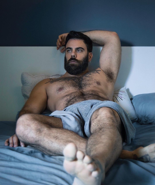 man in bed shirtless