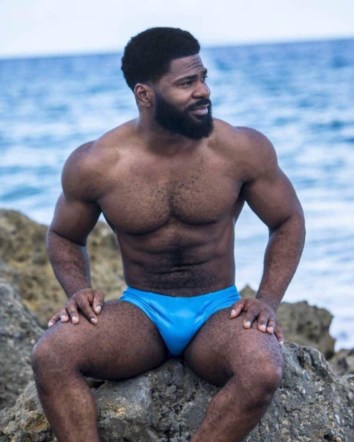 blue, handsome man in speedo