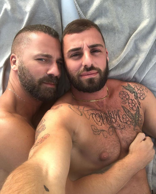 handsome couple in bed
