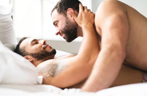 handsome couple in bed cuddling