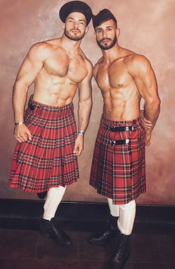 two shirtless men in kilts