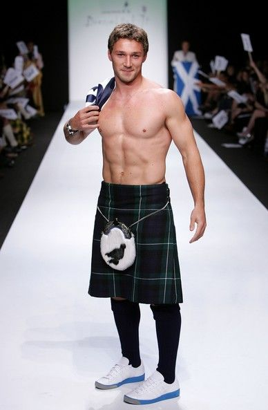 shirtless man in a kilt